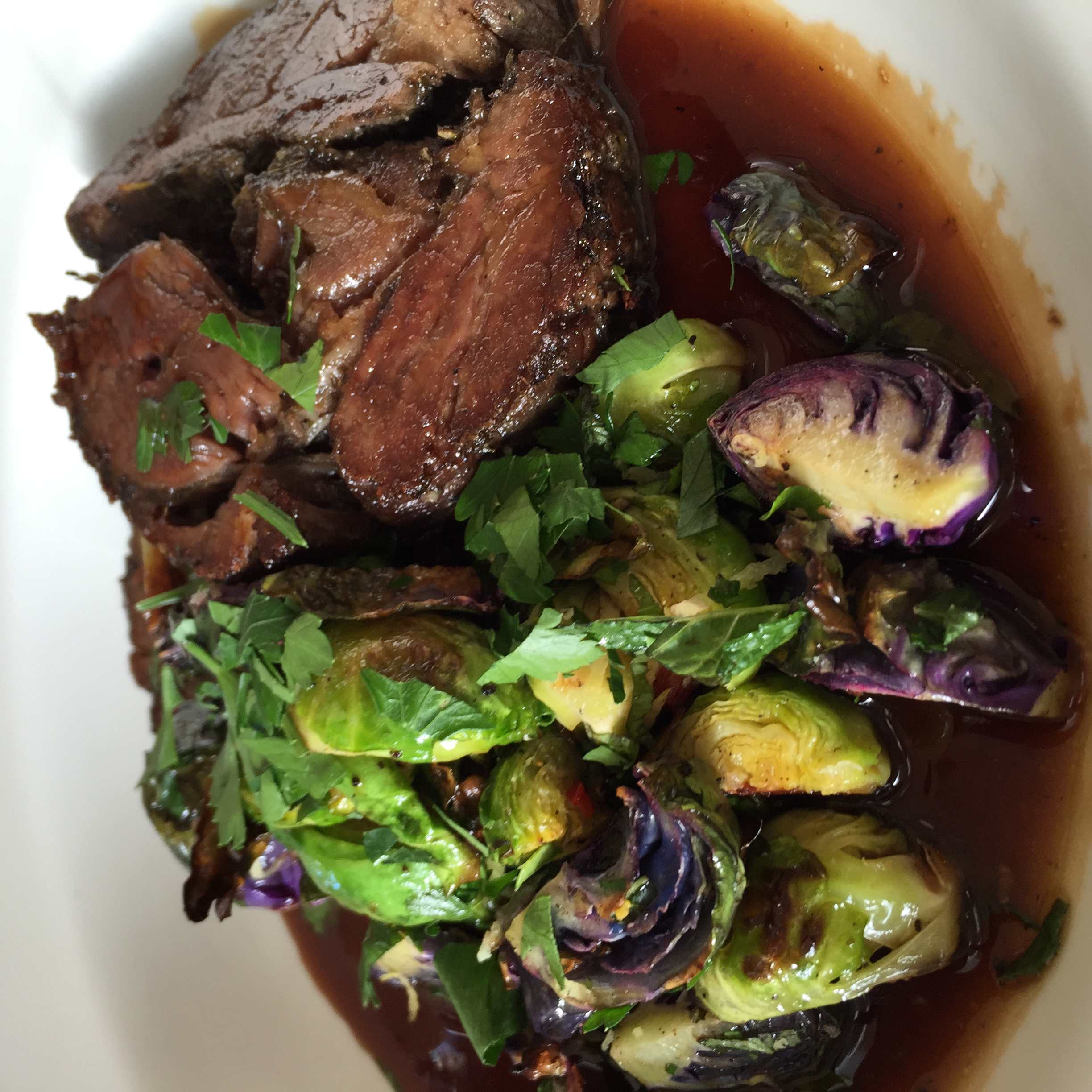 Lamb, slow cooked shoulder, roasted purple & green Brussels sprouts